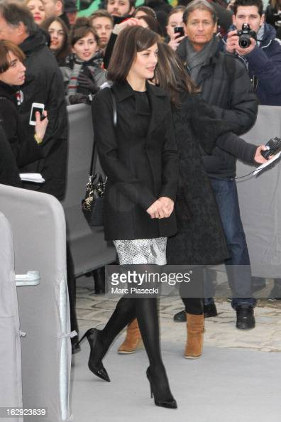 Actress Marion Cotillard attends the 'Christian Dior' Fall/Winter 2013 ReadytoWear show as part of Paris Fashion Week on March 1 2013 in Paris France