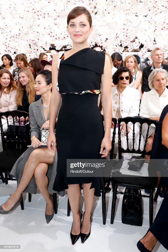 Actress Marion Cotillard attends the Christian Dior show as part of Paris Fashion Week - Haute Couture Fall/Winter 2014-2015. Held at Musee Rodin on July 7, 2014 in Paris, France.