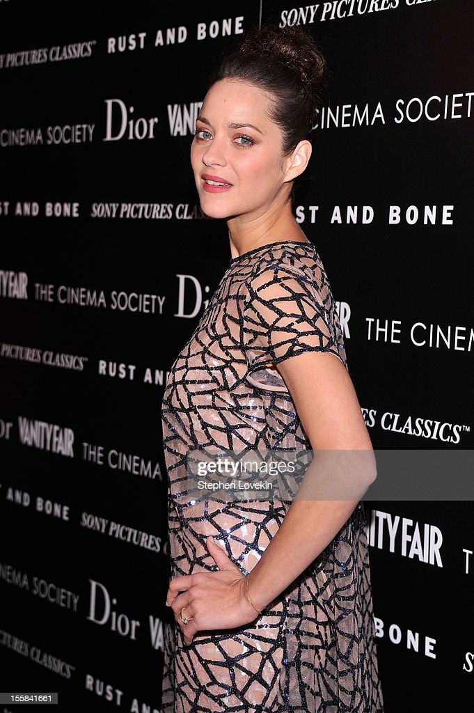 Actress <a gi-track='captionPersonalityLinkClicked' href=/galleries/search?phrase=Marion+Cotillard&family=editorial&specificpeople=215303 ng-click='$event.stopPropagation()'>Marion Cotillard</a> attends The Cinema Society with Dior & Vanity Fair screening of 'Rust And Bone' at Landmark Sunshine Cinema on November 8, 2012 in New York City.