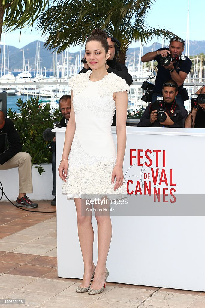 Actress <a gi-track='captionPersonalityLinkClicked' href=/galleries/search?phrase=Marion+Cotillard&family=editorial&specificpeople=215303 ng-click='$event.stopPropagation()'>Marion Cotillard</a> attends 'The Immigrant' photocall during The 66th Annual Cannes Film Festival at he Palais des Festivals on May 24, 2013 in Cannes, France.