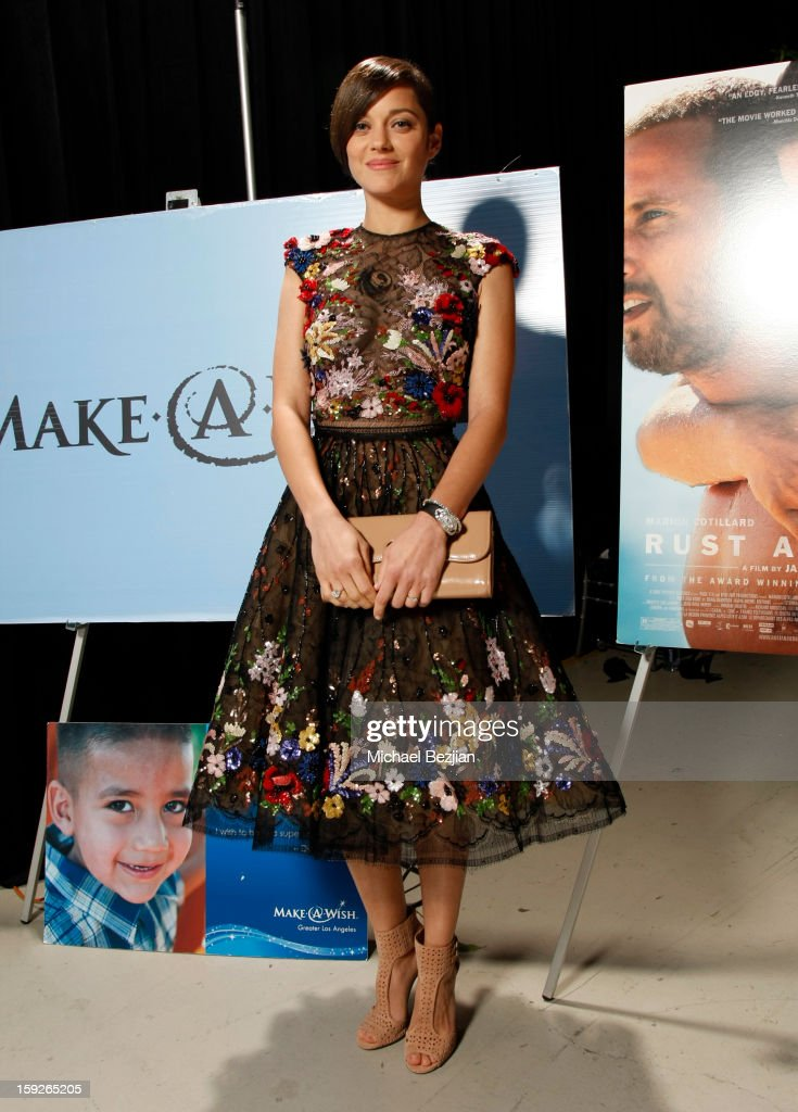 Actress <a gi-track='captionPersonalityLinkClicked' href=/galleries/search?phrase=Marion+Cotillard&family=editorial&specificpeople=215303 ng-click='$event.stopPropagation()'>Marion Cotillard</a> attends the poster signing event for charity during the Critics' Choice Movie Awards 2013 at Barkar Hangar on January 10, 2013 in Santa Monica, California.
