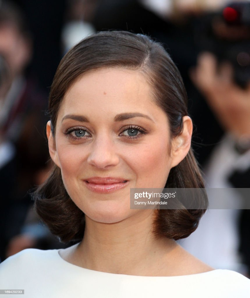 Actress <a gi-track='captionPersonalityLinkClicked' href=/galleries/search?phrase=Marion+Cotillard&family=editorial&specificpeople=215303 ng-click='$event.stopPropagation()'>Marion Cotillard</a> attends the Premiere of 'The Immigrant' at The 66th Annual Cannes Film Festival at Palais des Festivals on May 24, 2013 in Cannes, France.