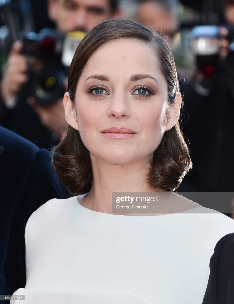 Actress <a gi-track='captionPersonalityLinkClicked' href=/galleries/search?phrase=Marion+Cotillard&family=editorial&specificpeople=215303 ng-click='$event.stopPropagation()'>Marion Cotillard</a> attends the premiere of 'The Immigrant' at The 66th Annual Cannes Film Festival on May 24, 2013 in Cannes, France.