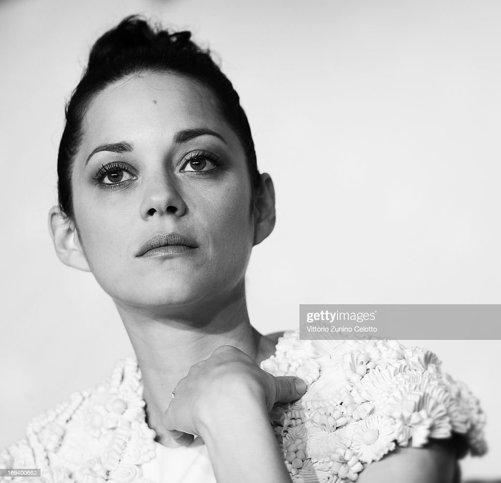 Actress <a gi-track='captionPersonalityLinkClicked' href=/galleries/search?phrase=Marion+Cotillard&family=editorial&specificpeople=215303 ng-click='$event.stopPropagation()'>Marion Cotillard</a> attends the press conference for 'The Immigrant' at The 66th Annual Cannes Film Festival at the Palais des Festivals on May 24, 2013 in Cannes, France.