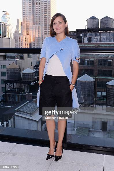 Actress Marion Cotillard attends the 'Two Days One Night' premiere hosted by Sundance Selects with Dior Beauty and The Cinema Society at Spyglass...