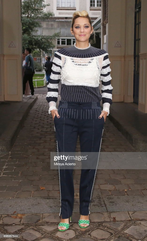 Actress, Marion Cotillard, attends the Valentino show as part of the Paris Fashion Week Womenswear Spring/Summer 2018 on October 1, 2017 in Paris, France.