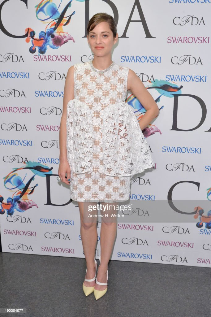 Actress <a gi-track='captionPersonalityLinkClicked' href=/galleries/search?phrase=Marion+Cotillard&family=editorial&specificpeople=215303 ng-click='$event.stopPropagation()'>Marion Cotillard</a> attends the winners walk during the 2014 CFDA fashion awards at Alice Tully Hall, Lincoln Center on June 2, 2014 in New York City.
