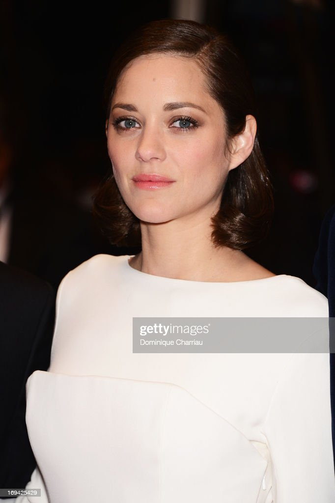 Actress Marion Cotillard departs the Premiere of 'The Immigrant' at The 66th Annual Cannes Film Festival at Palais des Festivals on May 24, 2013 in Cannes, France.