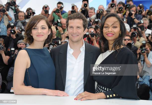 Actress Marion Cotillard director Guillaume Canet and actress Zoe Saldana attends the photocall for 'Blood Ties' at The 66th Annual Cannes Film...