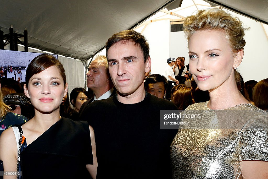 Actress Marion Cotillard, Fashion designer Raf Simons and Actress Charlize Theron pose backstage after the Christian Dior show as part of Paris Fashion Week - Haute Couture Fall/Winter 2014-2015. Held at Musee Rodin on July 7, 2014 in Paris, France.