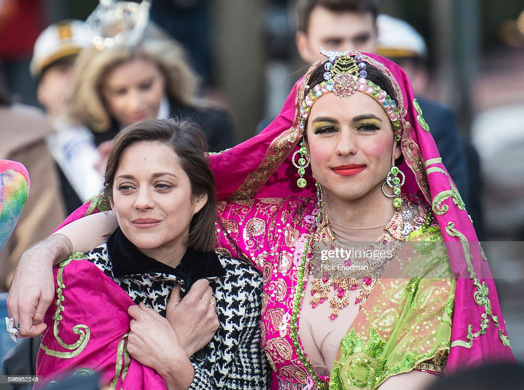 Actress Marion Cotillard Harvard's Hasty Pudding Theatricals Woman of the Year being paraded through Harvard Square during the annual parade with Ben...