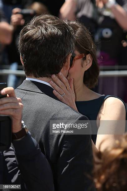 Actress Marion Cotillard hugs Guillaume Canet as she arrives to attend the 'Blood Ties' photocall at the 'Palais des Festivals' during the 66th...