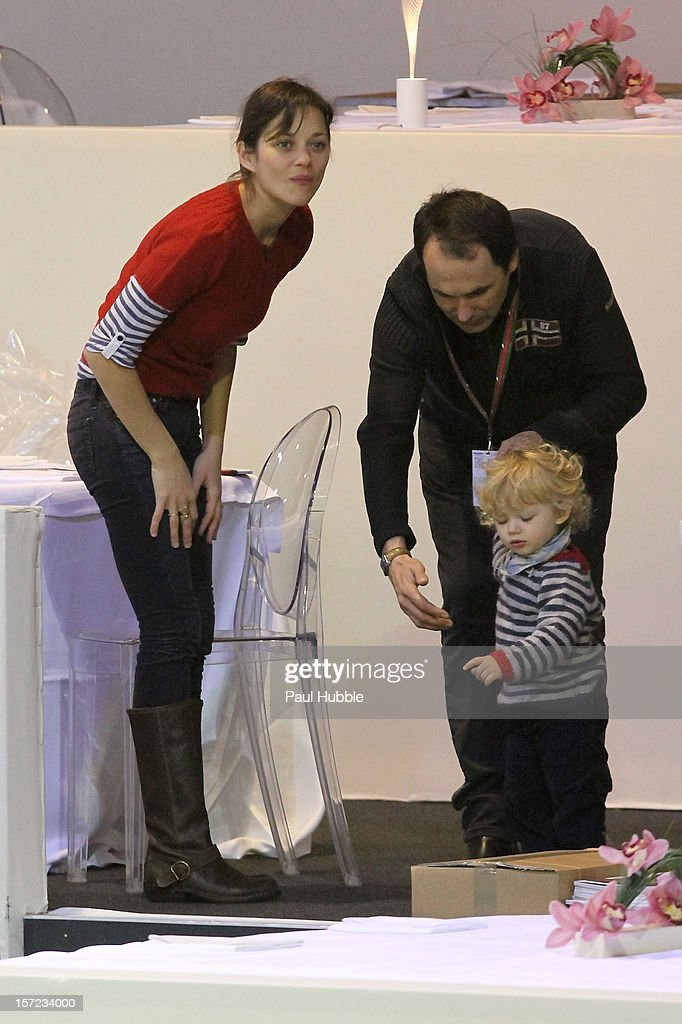 Actress <a gi-track='captionPersonalityLinkClicked' href=/galleries/search?phrase=Marion+Cotillard&family=editorial&specificpeople=215303 ng-click='$event.stopPropagation()'>Marion Cotillard</a> is sighted at the Gucci Paris Masters 2012 at Paris Nord Villepinte on November 30, 2012 in Paris, France.