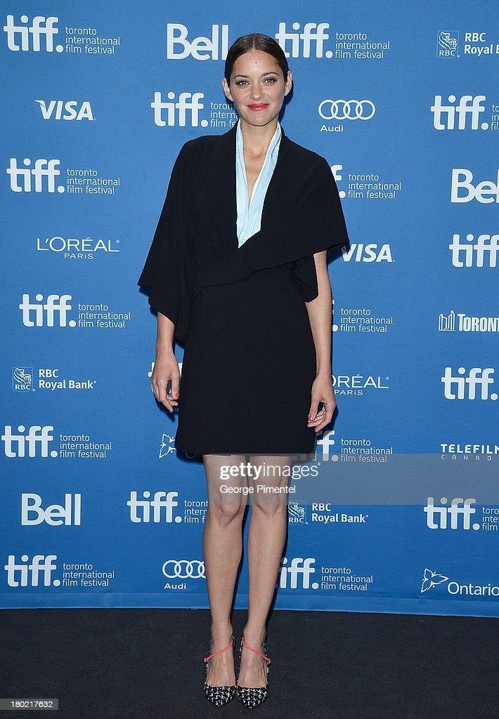 Actress Marion Cotillard poses at the 'Blood Ties' Press Conference during the 2013 Toronto International Film Festival at TIFF Bell Lightbox on September 10, 2013 in Toronto, Canada.