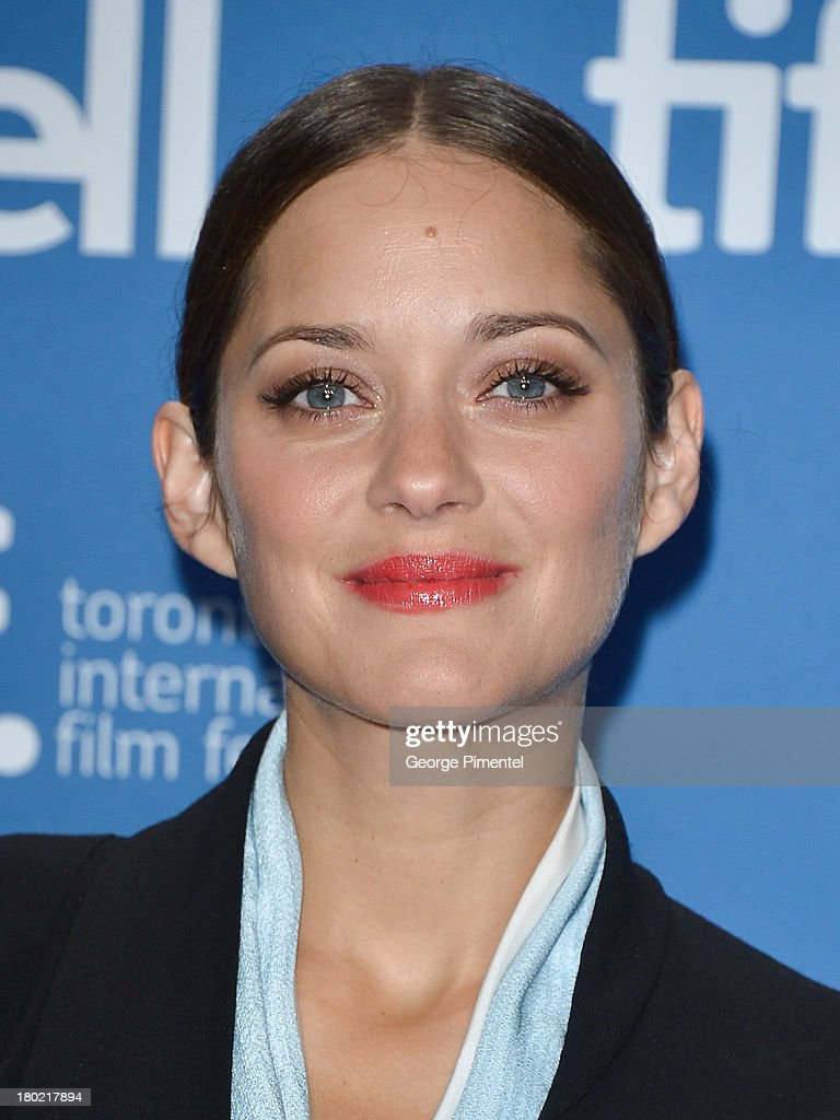 Actress <a gi-track='captionPersonalityLinkClicked' href=/galleries/search?phrase=Marion+Cotillard&family=editorial&specificpeople=215303 ng-click='$event.stopPropagation()'>Marion Cotillard</a> poses at the 'Blood Ties' Press Conference during the 2013 Toronto International Film Festival at TIFF Bell Lightbox on September 10, 2013 in Toronto, Canada.
