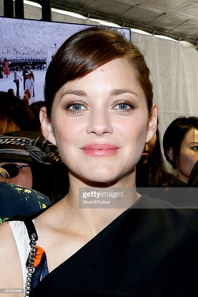 Actress Marion Cotillard poses backstage after the Christian Dior show as part of Paris Fashion Week - Haute Couture Fall/Winter 2014-2015. Held at Musee Rodin on July 7, 2014 in Paris, France.