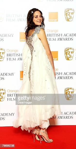 Actress Marion Cotillard poses in the Awards Room at The Orange British Academy Film Awards at the Royal Opera House on February 10 2008 in London...