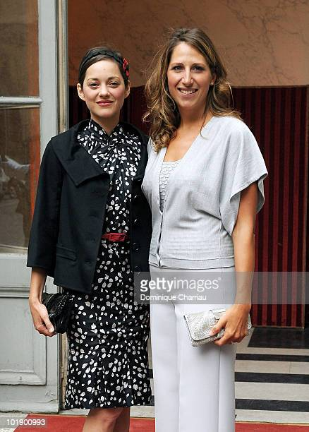 Actress Marion Cotillard poses With Maud Fontenoy as she arrives at the Soiree de gala Maud Fontenoy Fondation at Hotel de la Marine on June 8 2010...