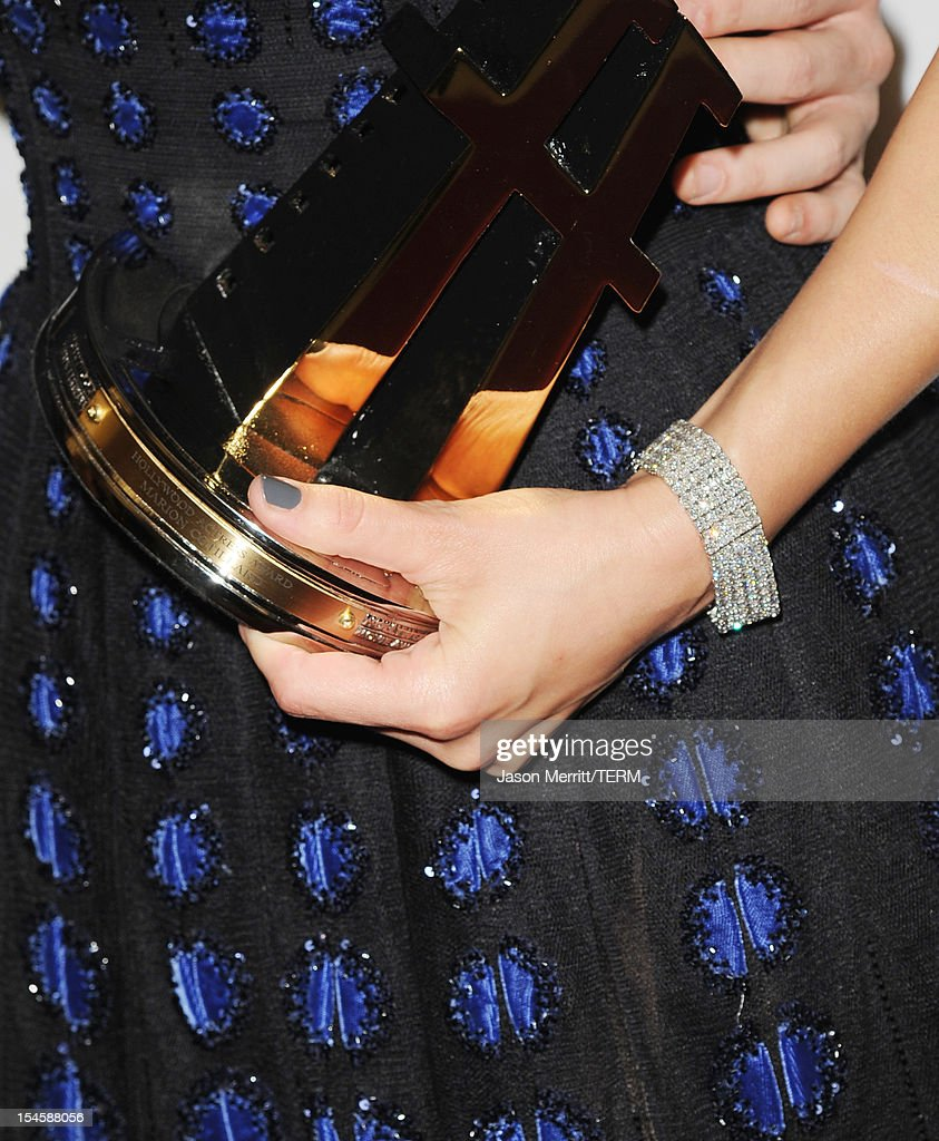 Actress Marion Cotillard (fashion detail) poses with the Hollywood Actress Award during the 16th Annual Hollywood Film Awards Gala presented by The Los Angeles Times held at The Beverly Hilton Hotel on October 22, 2012 in Beverly Hills, California.
