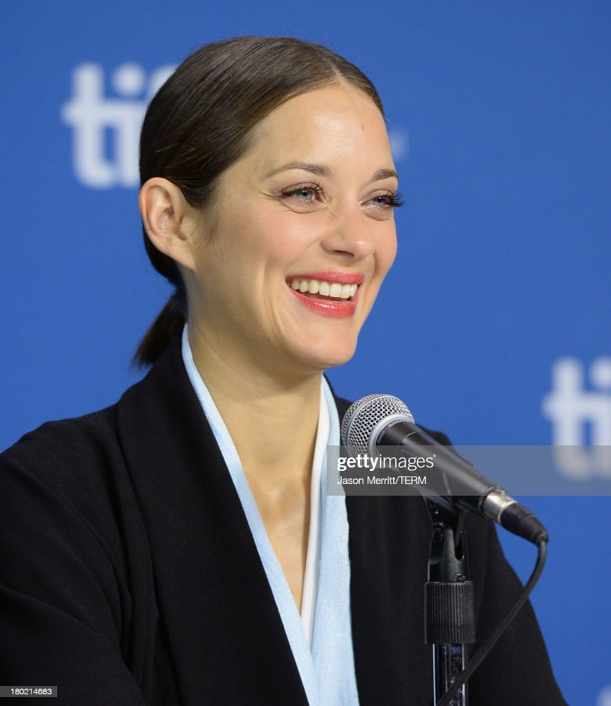 Actress <a gi-track='captionPersonalityLinkClicked' href=/galleries/search?phrase=Marion+Cotillard&family=editorial&specificpeople=215303 ng-click='$event.stopPropagation()'>Marion Cotillard</a> speaks onstage at 'Blood Ties' Press Conference during the 2013 Toronto International Film Festival at TIFF Bell Lightbox on September 10, 2013 in Toronto, Canada.