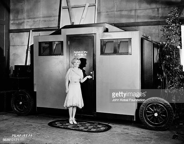 Actress Marion Davies entering her trailer on a film set for MGM Studios April 13th 1909