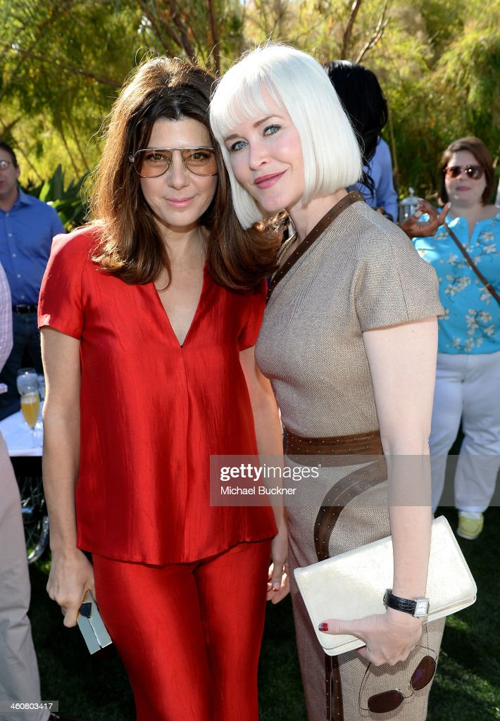 Actress <a gi-track='captionPersonalityLinkClicked' href=/galleries/search?phrase=Marisa+Tomei&family=editorial&specificpeople=201516 ng-click='$event.stopPropagation()'>Marisa Tomei</a> and writer Gren Wells attend Variety's Creative Impact Awards and 10 Directors to Watch brunch presented by Mercedes-Benz at The 25th Annual Palm Springs International Film Festival at Parker Palm Springs on January 5, 2014 in Palm Springs, California.