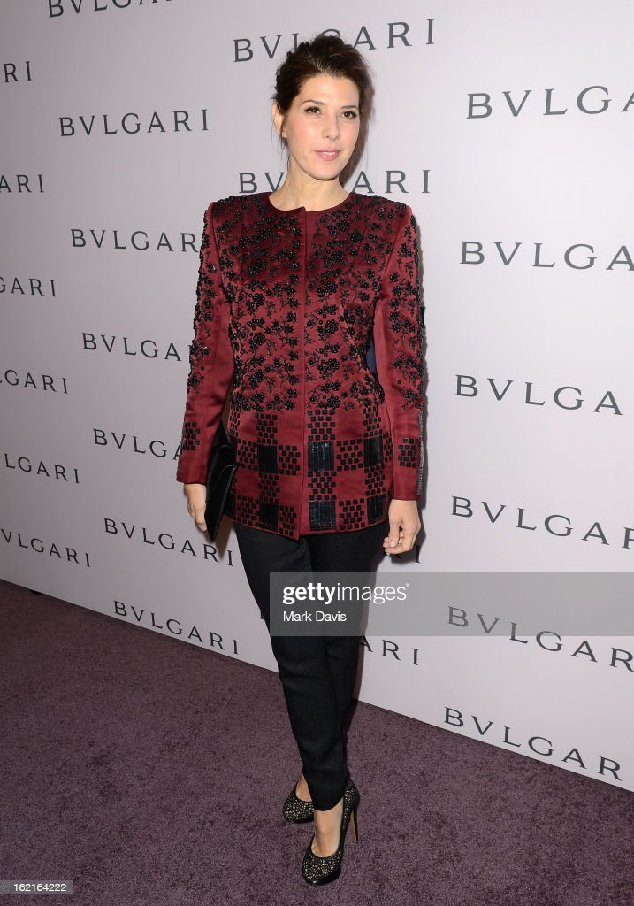 Actress Marisa Tomei, wearing BVLGARI, arrives at the BVLGARI celebration of Elizabeth Taylor's collection of BVLGARI jewelry at BVLGARI Beverly Hills on February 19, 2013 in Los Angeles, California.