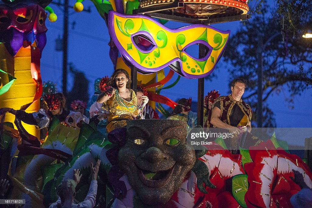 Actress Mariska Hargitay and musician Harry Connick Jr toss Mardi Gras beads to fans and revelers in the 2013 Krewe of Orpheus Parade on February 11, 2013 in New Orleans, Louisiana.