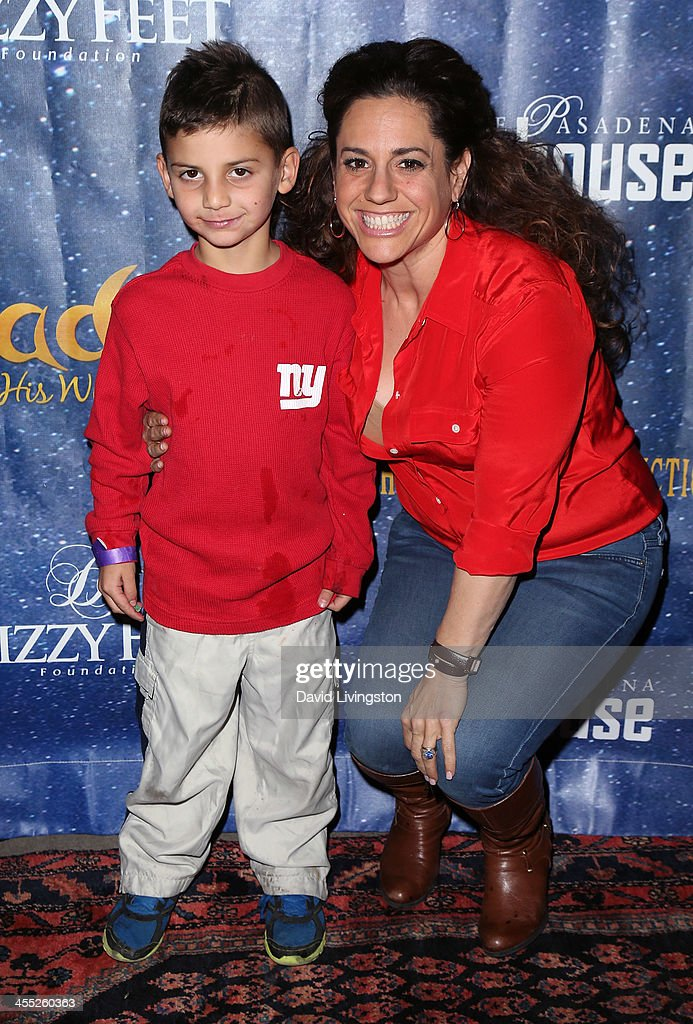 Actress <a gi-track='captionPersonalityLinkClicked' href=/galleries/search?phrase=Marissa+Jaret+Winokur&family=editorial&specificpeople=206425 ng-click='$event.stopPropagation()'>Marissa Jaret Winokur</a> (R) and son Zev Isaac Miller attend 'Aladdin and His Winter Wish' opening night at the Pasadena Playhouse on December 11, 2013 in Pasadena, California.