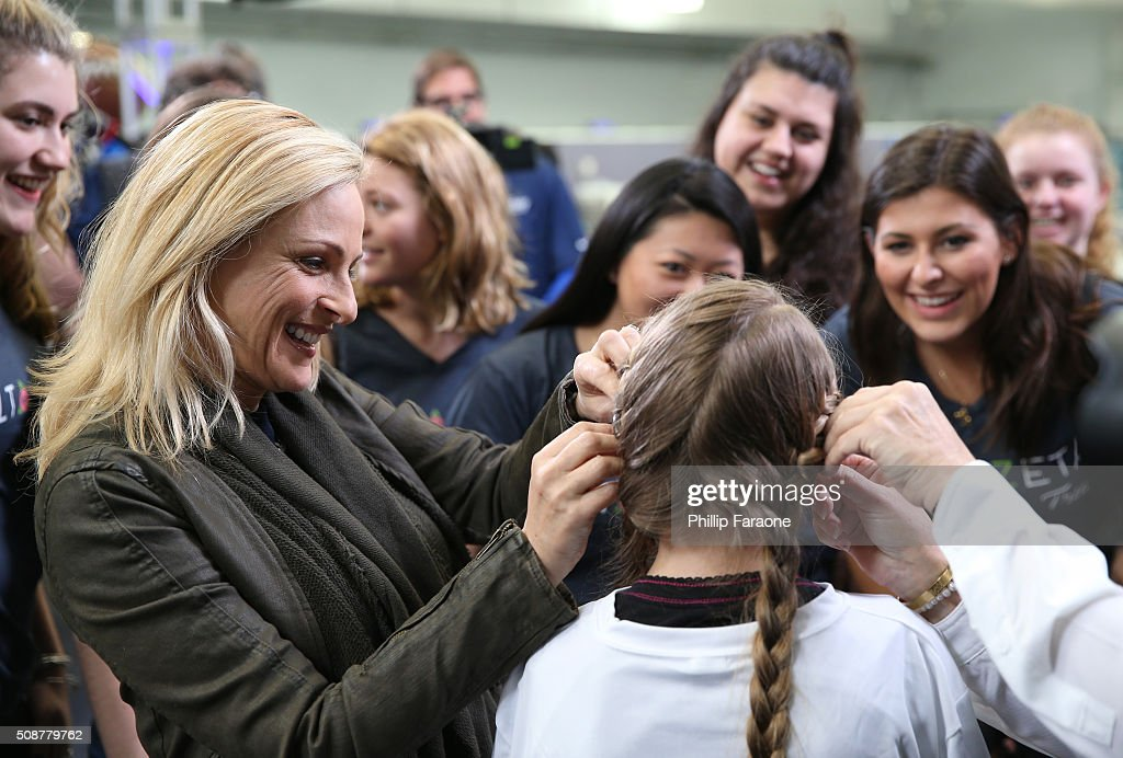 Actress <a gi-track='captionPersonalityLinkClicked' href=/galleries/search?phrase=Marlee+Matlin&family=editorial&specificpeople=173454 ng-click='$event.stopPropagation()'>Marlee Matlin</a> helps patient Cassie during the Starkey Hearing Foundation hearing mission during Super Bowl weekend 2016 at San Francisco State University on February 6, 2016 in San Francisco, California.