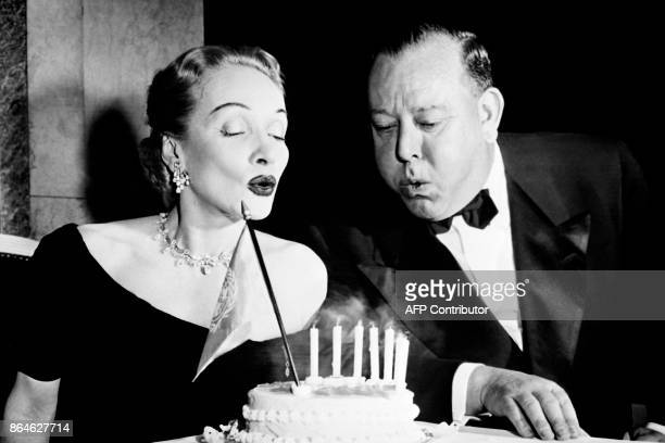 Actress Marlene Dietrich and first SecretaryGeneral of the United Nations Trygve Lie blow the candles of the 7th anniversary of the United Nations in...