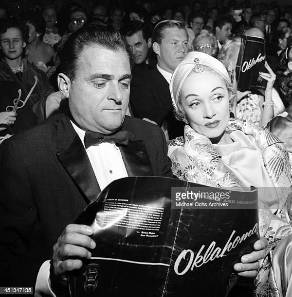 Actress Marlene Dietrich and Mike Todd attend the show 'Oklahoma' in Los Angeles California