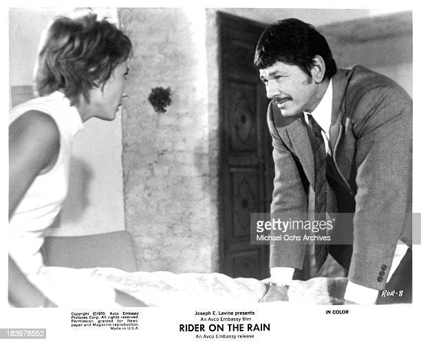 Actress Marlene Jobert and actor Charles Bronson on set of the Embassy Pictures movie 'Rider on the Rain' in 1970