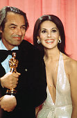 Actress Marlo Thomas poses backstage with Leonard Rosenman winner of 'Best Original Song Score or Adaptation Score' during the 48th Academy Awards at...