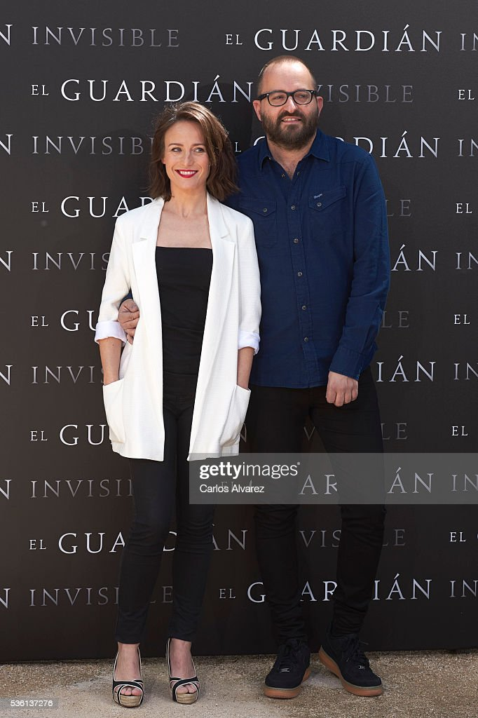 Actress <a gi-track='captionPersonalityLinkClicked' href=/galleries/search?phrase=Marta+Etura&family=editorial&specificpeople=789541 ng-click='$event.stopPropagation()'>Marta Etura</a> and director Fernando Gonzalez Molina attend 'El Guardian Invisible' photocall on May 31, 2016 in Madrid, Spain.