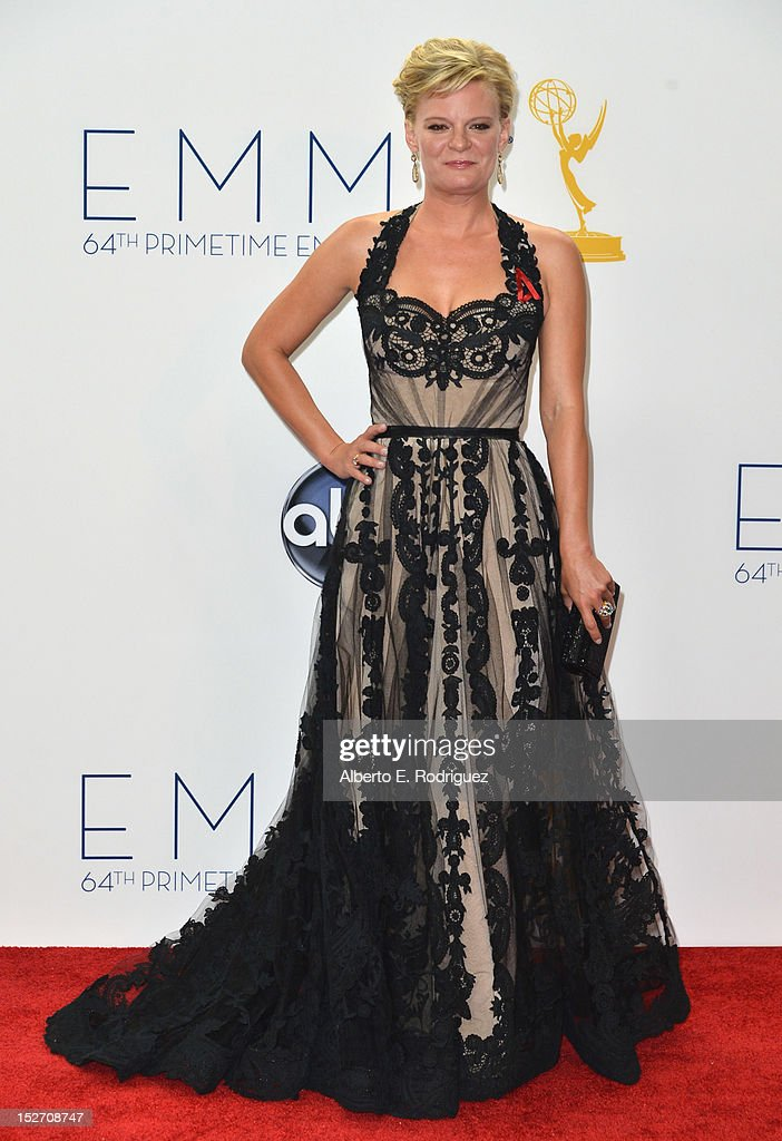 Actress Martha Plimpton poses in the 64th Annual Emmy Awards press room at Nokia Theatre L.A. Live on September 23, 2012 in Los Angeles, California.