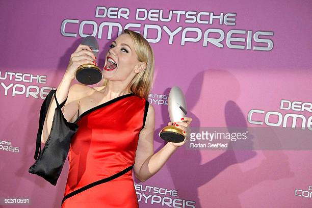 Actress Martina Hill poses with her awards at the German Comedy Award 2009 at the Coloneum on October 20 2009 in Cologne Germany