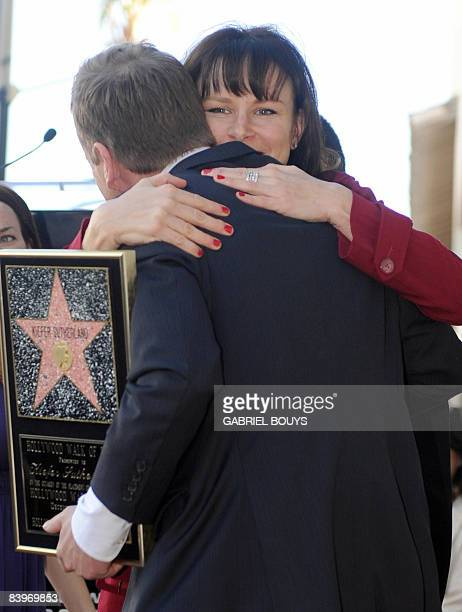 Actress Mary Lynn Rajskub hugs Canadian actor Kiefer Sutherland as he is honored with the 2377th Star on the Hollywood Walk of Fame December 9 2008...