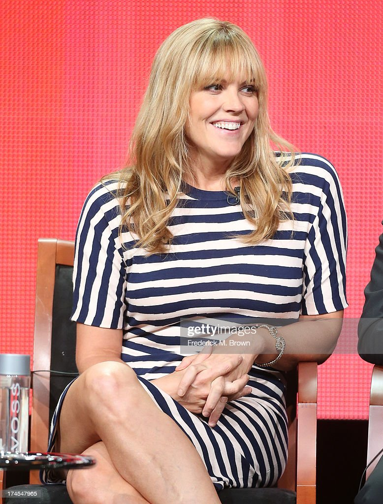 Actress Mary McCormack speaks onstage during the 'Welcome to the Family' panel discussion at the NBC portion of the 2013 Summer Television Critics Association tour - Day 4 at the Beverly Hilton Hotel on July 27, 2013 in Beverly Hills, California.