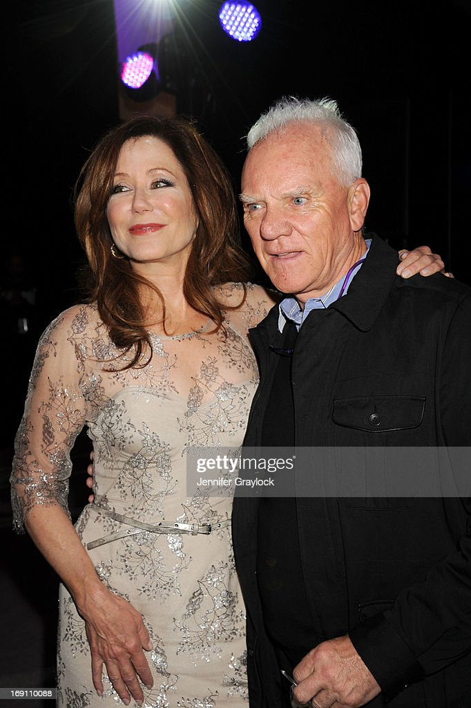 Actress Mary McDonnell and Actor Malcolm McDowell attend the 2013 TNT/TBS Upfront presentation at Hammerstein Ballroom on May 15, 2013 in New York City.