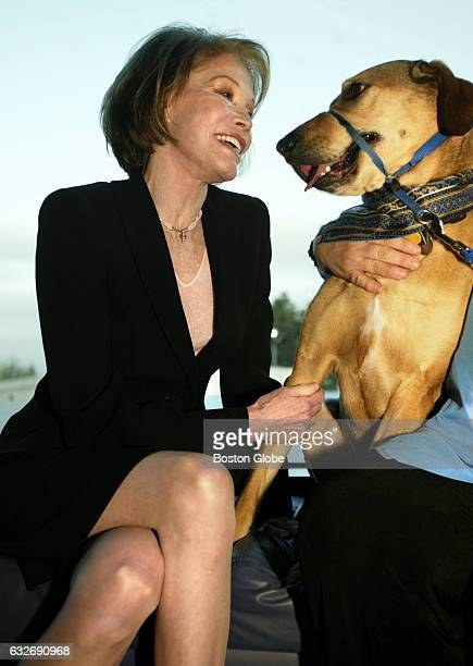 Actress Mary Tyler Moore greets canine hero Shelby at the JFK Library in Boston on May 13 2004 Both were presented with awards during the MSPCAAngell...