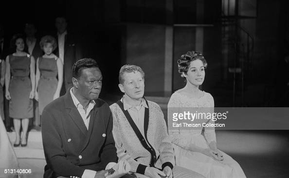 Actress Mary Tyler Moore singer Nat 'King' Cole and actor Danny Kaye on the set of The Dick Van Dyke Show on December 2 1963 in Los Angeles California