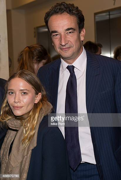 Actress MaryKate Olsen and Olivier Sarkozy attend the 2014 Take Home A Nude Event at Sotheby's on October 9 2014 in New York City