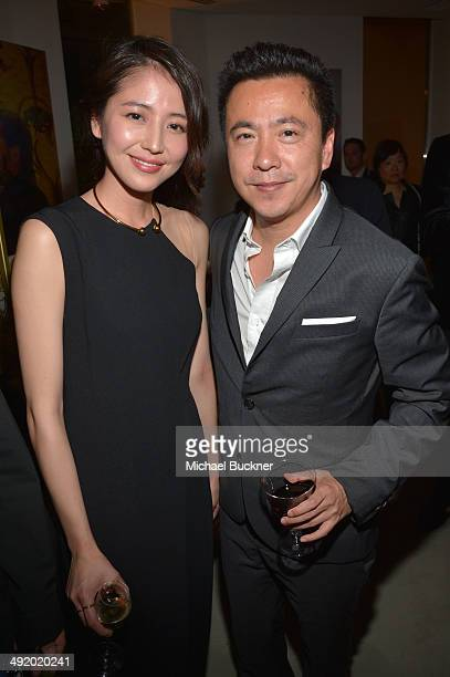 Actress Masami Nagasawa and James Wang chief executive officer of Huayi Brothers Media Corp attend the Huayi Brothers At 20 Party during the 67th...
