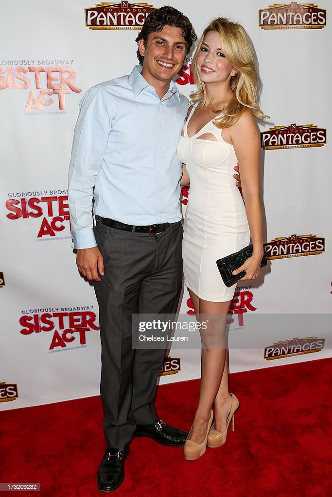 Actress Masiela Lusha (R) and fiancee arrive at the 'Sister Act' opening night premiere at the Pantages Theatre on July 9, 2013 in Hollywood, California.
