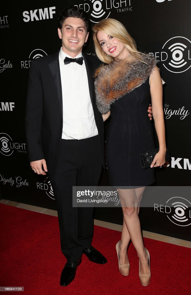 Actress Masiela Lusha (R) and financier Ramzi Habibi attend the launch of the Redlight Traffic app at the Dignity Gala at The Beverly Hilton Hotel on October 18, 2013 in Beverly Hills, California.