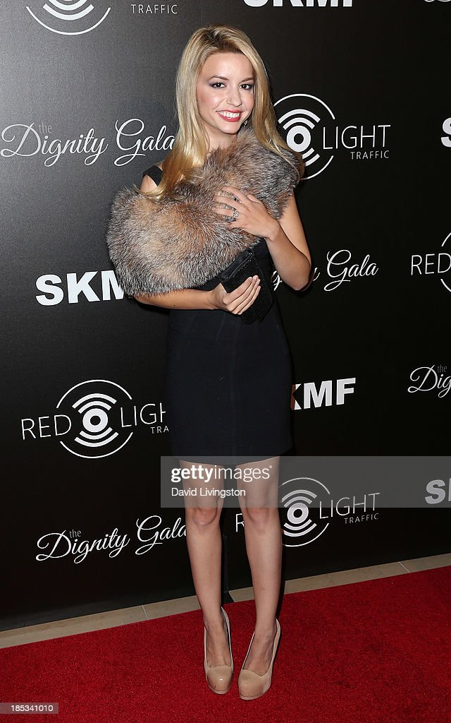 Actress <a gi-track='captionPersonalityLinkClicked' href=/galleries/search?phrase=Masiela+Lusha&family=editorial&specificpeople=213392 ng-click='$event.stopPropagation()'>Masiela Lusha</a> attends the launch of the Redlight Traffic app at the Dignity Gala at The Beverly Hilton Hotel on October 18, 2013 in Beverly Hills, California.