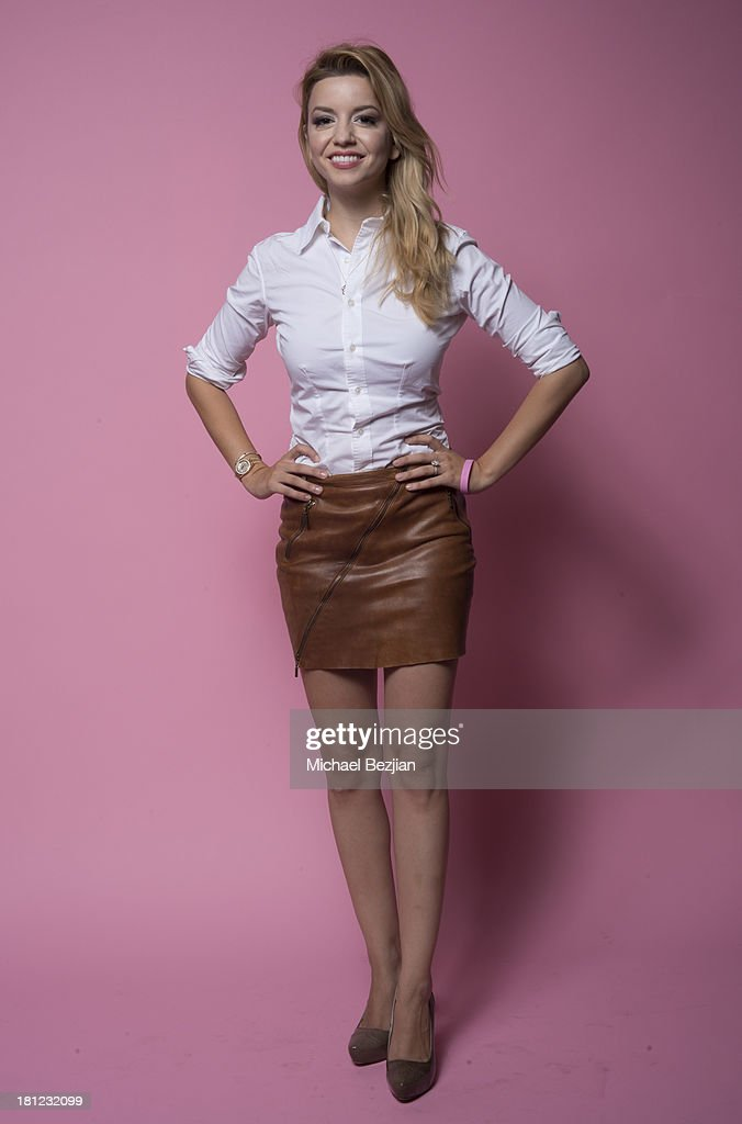 Actress Masiela Lusha poses for portraits at the Mark Kearney Group - 'Iced Out' Luxury Emmy Suite on September 19, 2013 in Los Angeles, California.