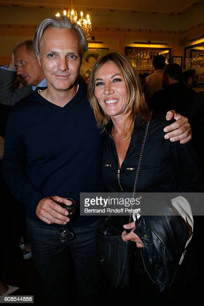 Actress Mathilde Seigner with her companion Mathieu Petit attend the 'Tout ce que vous voulez' Theater Play at Theatre Edouard VII on September 19...