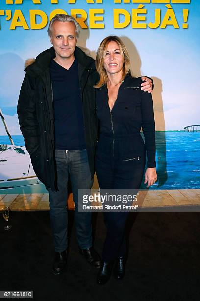 Actress Mathilde Seigner with her companion Mathieu Petit attend the 'Ma famille t'adore deja' Paris Premiere at Cinema Elysee Biarritz on November 7...